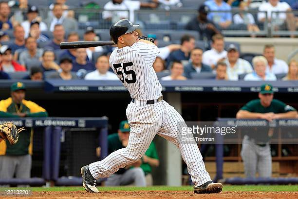 Russell Martin of the New York Yankees hits a grand slam home run in the 6th inning against the Oakland Athletics on August 25 2011 at Yankee Stadium...