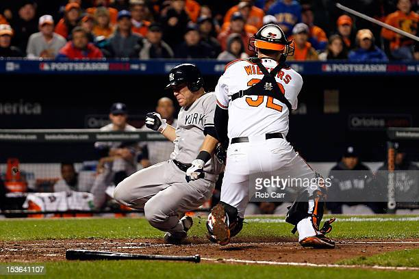 Russell Martin of the New York Yankees is tagged out at home trying to score against Matt Wieters of the Baltimore Orioles in the top of the seventh...