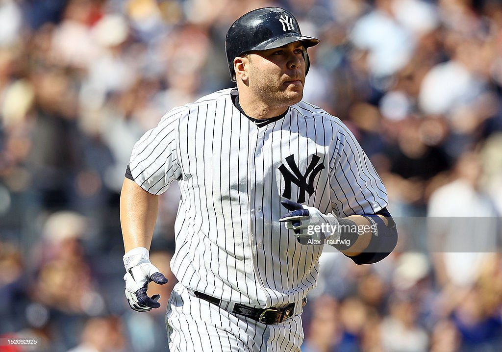 <a gi-track='captionPersonalityLinkClicked' href=/galleries/search?phrase=Russell+Martin+-+Baseball+Player&family=editorial&specificpeople=13764024 ng-click='$event.stopPropagation()'>Russell Martin</a> #55 of the New York Yankees looks on after hitting a three run home run against the Tampa Bay Rays at Yankee Stadium on September 16, 2012 in the Bronx borough of New York City.