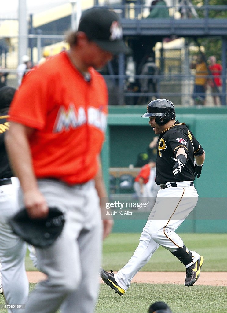 <a gi-track='captionPersonalityLinkClicked' href=/galleries/search?phrase=Russell+Martin+-+Baseball+Player&family=editorial&specificpeople=13764024 ng-click='$event.stopPropagation()'>Russell Martin</a> #55 of the Pittsburgh Pirates celebrates after hitting a game-winning RBI single in the tenth inning against the Miami Marlins during the game on August 8, 2013 at PNC Park in Pittsburgh, Pennsylvania.