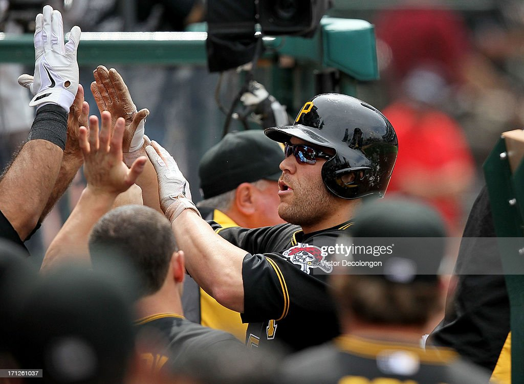 Russell Martin #55 of the Pittsburgh Pirates celebrates in the dugout after scoring on a single by Starling Marte #6 (not in photo) in the ninth inning to tie the game at 6-6 during the MLB game against the Los Angeles Angels of Anaheim at Angel Stadium of Anaheim on June 23, 2013 in Anaheim, California. The Pirates defeated the Angels 10-9 in ten innings.