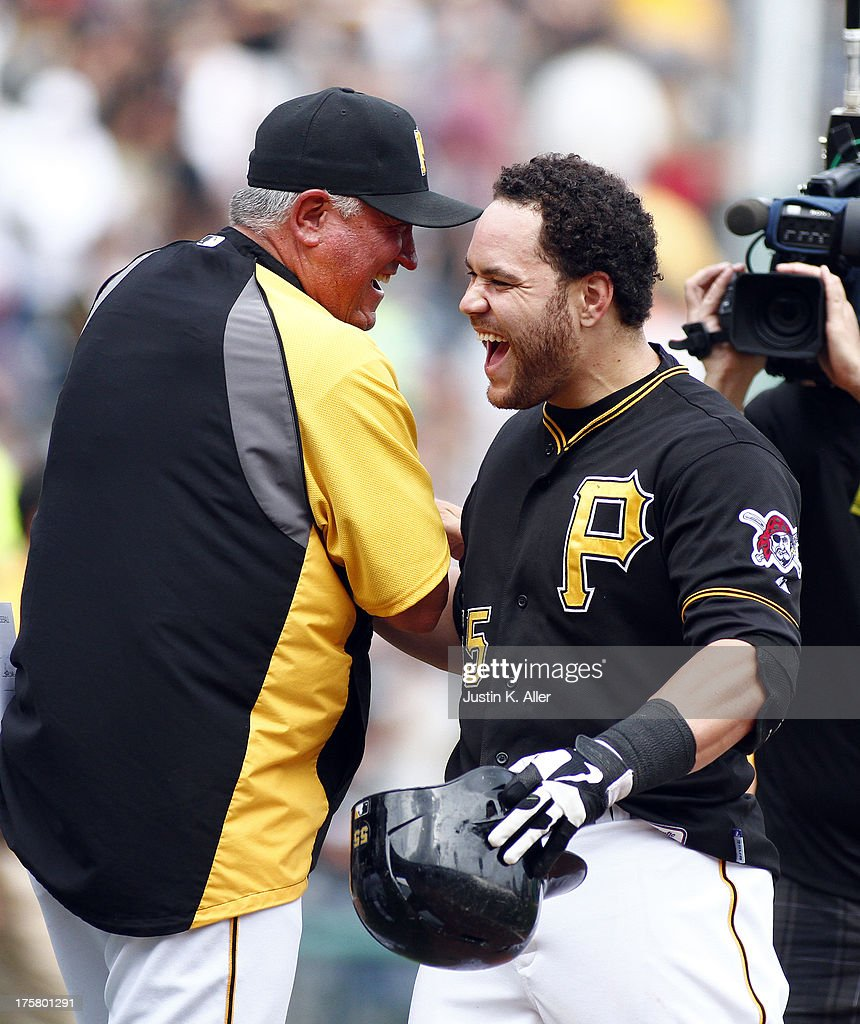 <a gi-track='captionPersonalityLinkClicked' href=/galleries/search?phrase=Russell+Martin+-+Baseball+Player&family=editorial&specificpeople=13764024 ng-click='$event.stopPropagation()'>Russell Martin</a> #55 of the Pittsburgh Pirates celebrates with manager <a gi-track='captionPersonalityLinkClicked' href=/galleries/search?phrase=Clint+Hurdle&family=editorial&specificpeople=223975 ng-click='$event.stopPropagation()'>Clint Hurdle</a> #13 after hitting a game winning RBI single in the tenth inning against the Miami Marlins during the game on August 8, 2013 at PNC Park in Pittsburgh, Pennsylvania.