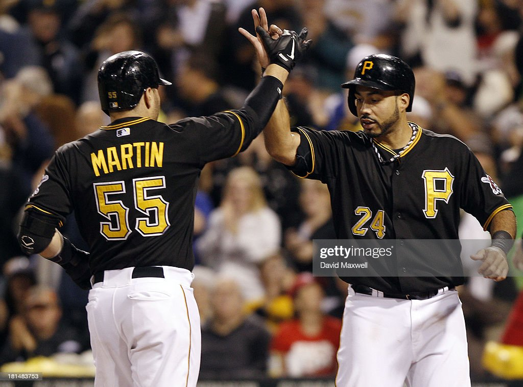 <a gi-track='captionPersonalityLinkClicked' href=/galleries/search?phrase=Russell+Martin+-+Baseball+Player&family=editorial&specificpeople=13764024 ng-click='$event.stopPropagation()'>Russell Martin</a> #55 of the Pittsburgh Pirates celebrates with teammate Pedro Alvarez #24 at home plate after hitting a two-run home run against the Cincinnati Reds during the second inning of their game on September 21, 2013 at PNC Park in Pittsburgh Pennsylvania.