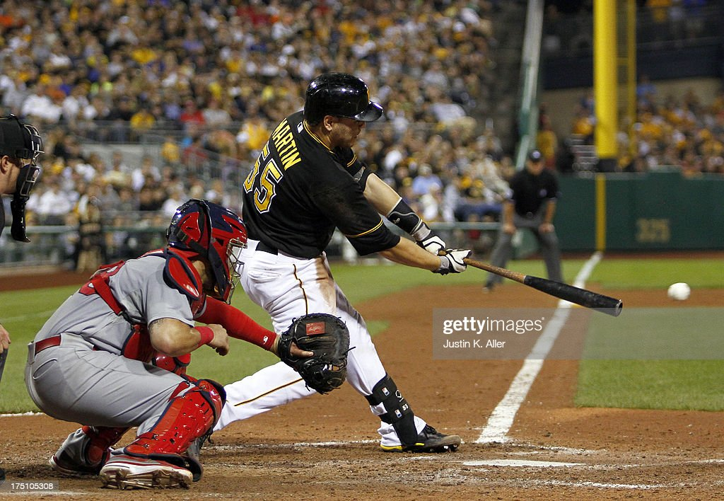 <a gi-track='captionPersonalityLinkClicked' href=/galleries/search?phrase=Russell+Martin+-+Baseball+Player&family=editorial&specificpeople=13764024 ng-click='$event.stopPropagation()'>Russell Martin</a> #55 of the Pittsburgh Pirates hits an RBI single in the eighth inning against the St. Louis Cardinals during the game on July 31, 2013 at PNC Park in Pittsburgh, Pennsylvania.