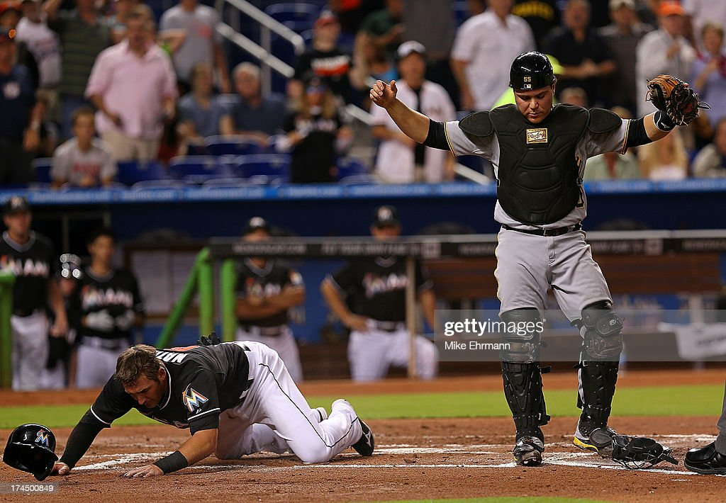 <a gi-track='captionPersonalityLinkClicked' href=/galleries/search?phrase=Russell+Martin+-+Baseball+Player&family=editorial&specificpeople=13764024 ng-click='$event.stopPropagation()'>Russell Martin</a> #55 of the Pittsburgh Pirates reacts after tagging out <a gi-track='captionPersonalityLinkClicked' href=/galleries/search?phrase=Jeff+Mathis&family=editorial&specificpeople=660661 ng-click='$event.stopPropagation()'>Jeff Mathis</a> #6 of the Miami Marlins at home during a game at Marlins Park on July 26, 2013 in Miami, Florida.