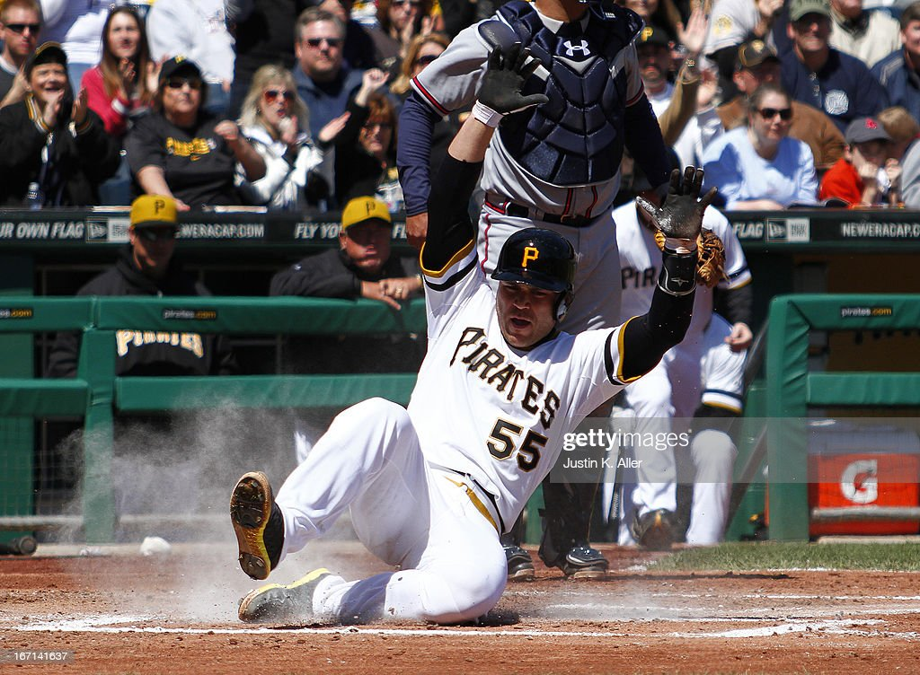 Russell Martin #55 of the Pittsburgh Pirates scores on an RBI single in the second inning against the Atlanta Braves during the game on April 21, 2013 at PNC Park in Pittsburgh, Pennsylvania.