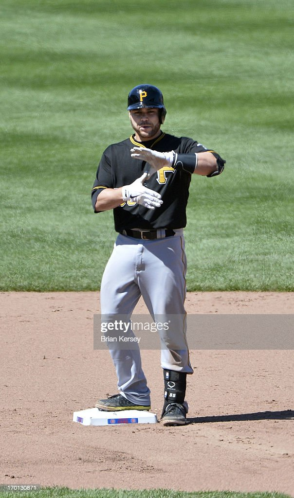 <a gi-track='captionPersonalityLinkClicked' href=/galleries/search?phrase=Russell+Martin+-+Baseball+Player&family=editorial&specificpeople=13764024 ng-click='$event.stopPropagation()'>Russell Martin</a> #55 of the Pittsburgh Pirates stands on second base after hitting an RBI double scoring teammate Jordy Mercer #10 during the sixth inning against the Chicago Cubs at Wrigley Field on June 7, 2013 in Chicago, Illinois.