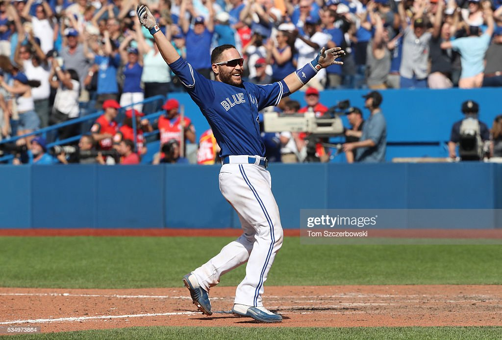 Russell Martin #55 of the Toronto Blue Jays celebrates as he scores the game-winning run in the ninth inning on their walk-off victory during MLB game action against the Boston Red Sox on May 28, 2016 at Rogers Centre in Toronto, Ontario, Canada.
