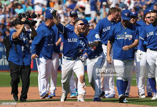 Russell Martin of the Toronto Blue Jays celebrates their walkoff victory during MLB game action against the Boston Red Sox on May 28 2016 at Rogers...