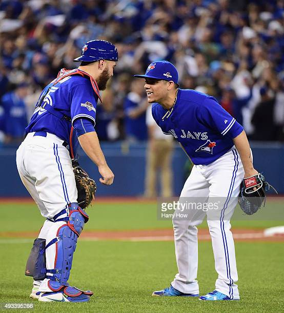 Russell Martin of the Toronto Blue Jays celebrates with Roberto Osuna of the Toronto Blue Jays after defeating the Kansas City Royals 118 in game...