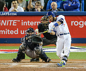 TORONTO ON MAY 6 Russell Martin of the Toronto Blue Jays crushes a home run to Left in the 6th inning during the game between the Toronto Blue Jays...