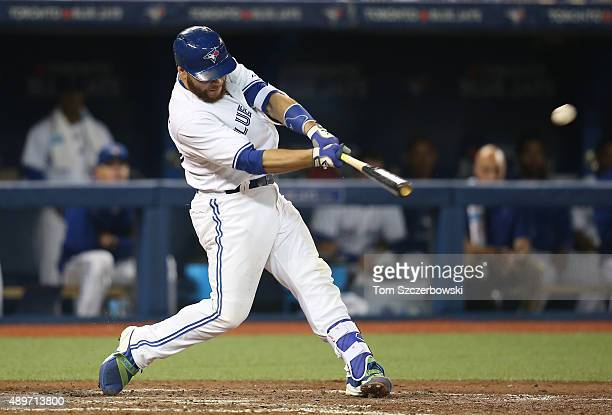 Russell Martin of the Toronto Blue Jays hits a threerun home run in the seventh inning during MLB game action against the New York Yankees on...