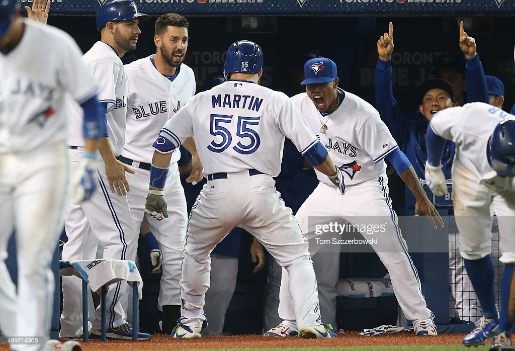 Russell Martin #55 of the Toronto Blue Jays is congratulated by Marcus Stroman #6 and Chris Colabello #15 after hitting a three-run home run in the seventh inning during MLB game action against the New York Yankees on September 23, 2015 at Rogers Centre in Toronto, Ontario, Canada.