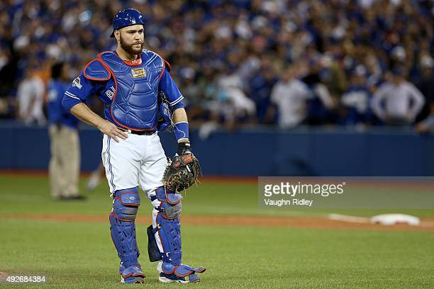 Russell Martin of the Toronto Blue Jays reacts in the seventh inning after an error was called on Martin allowing a run to score for the Texas...