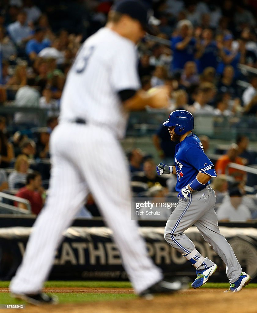 Russell Martin #55 of the Toronto Blue Jays rounds the bases after hitting a two run home run off Chasen Shreve #45 of the New York Yankees in the seventh inning of a MLB baseball game at Yankee Stadium on September 11, 2015 in the Bronx borough of New York City. The Blue Jays defeated the Yankees 11-5.