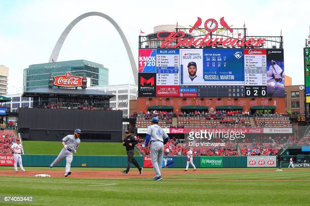 Russell Martin of the Toronto Blue Jays rounds third base after hitting a solo home run against the St Louis Cardinals in the second inning at Busch...