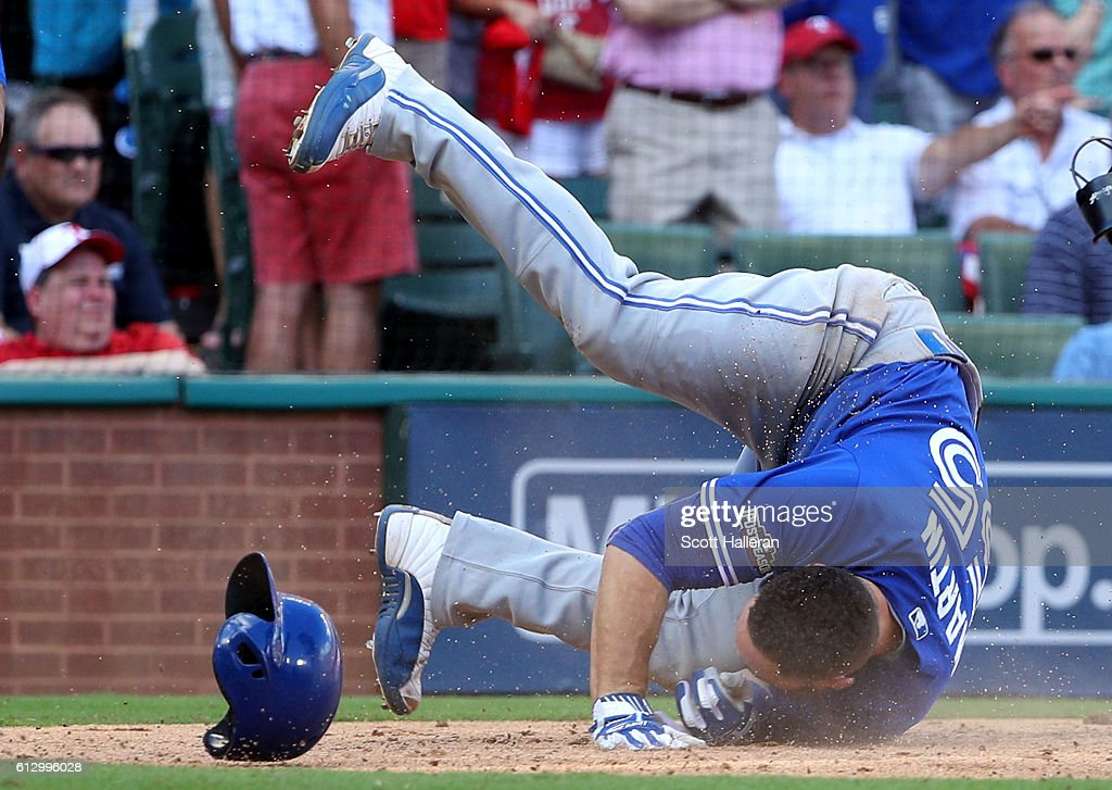 Russell Martin #55 of the Toronto Blue Jays socres a run off of Troy Tulowitzki #2 RBI triple to right field against Cole Hamels #35 of the Texas Rangers during the third inning in game one of the American League Divison Series at Globe Life Park in Arlington on October 6, 2016 in Arlington, Texas.