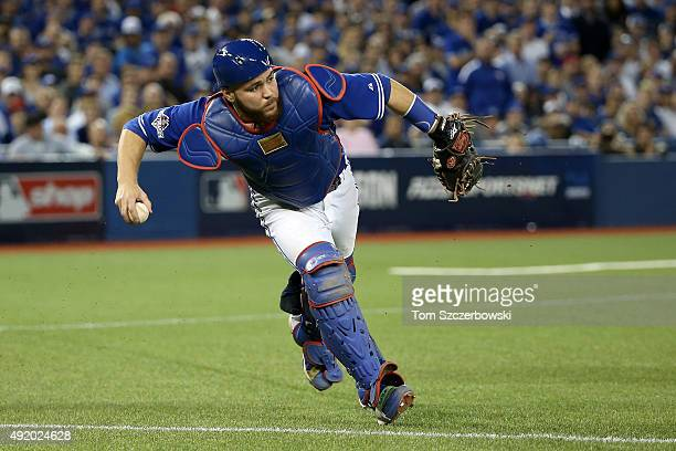 Russell Martin of the Toronto Blue Jays throws to first for the final out of the top of the tenth inning against the Texas Rangers during game two of...
