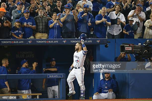 Russell Martin of the Toronto Blue Jays tips his helmet to fans following his threerun home run in the seventh inning during MLB game action against...