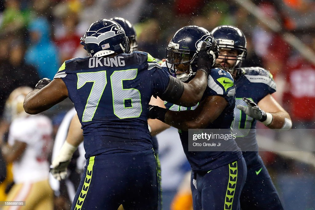 <a gi-track='captionPersonalityLinkClicked' href=/galleries/search?phrase=Russell+Okung&family=editorial&specificpeople=4046517 ng-click='$event.stopPropagation()'>Russell Okung</a> #76 and <a gi-track='captionPersonalityLinkClicked' href=/galleries/search?phrase=Marshawn+Lynch&family=editorial&specificpeople=2159904 ng-click='$event.stopPropagation()'>Marshawn Lynch</a> #24 of the Seattle Seahawks celebrate after Lynch scored a 24-yard rushing touchdown in the first quarter against the San Francisco 49ers at Qwest Field on December 23, 2012 in Seattle, Washington.