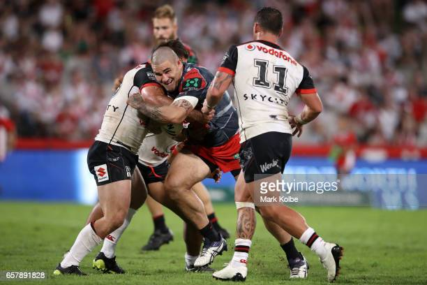 Russell Packer of the Dragons is tackled during the round four NRL match between the St George Illawarra Dragons and the New Zealand Warriors at UOW...