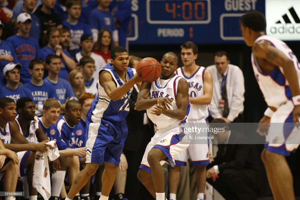 Russell Robinson of Kansas gets a ball in the face during 1st half action against the New Orleans Privateers at Allen Fieldhouse in Lawrence Kansas...
