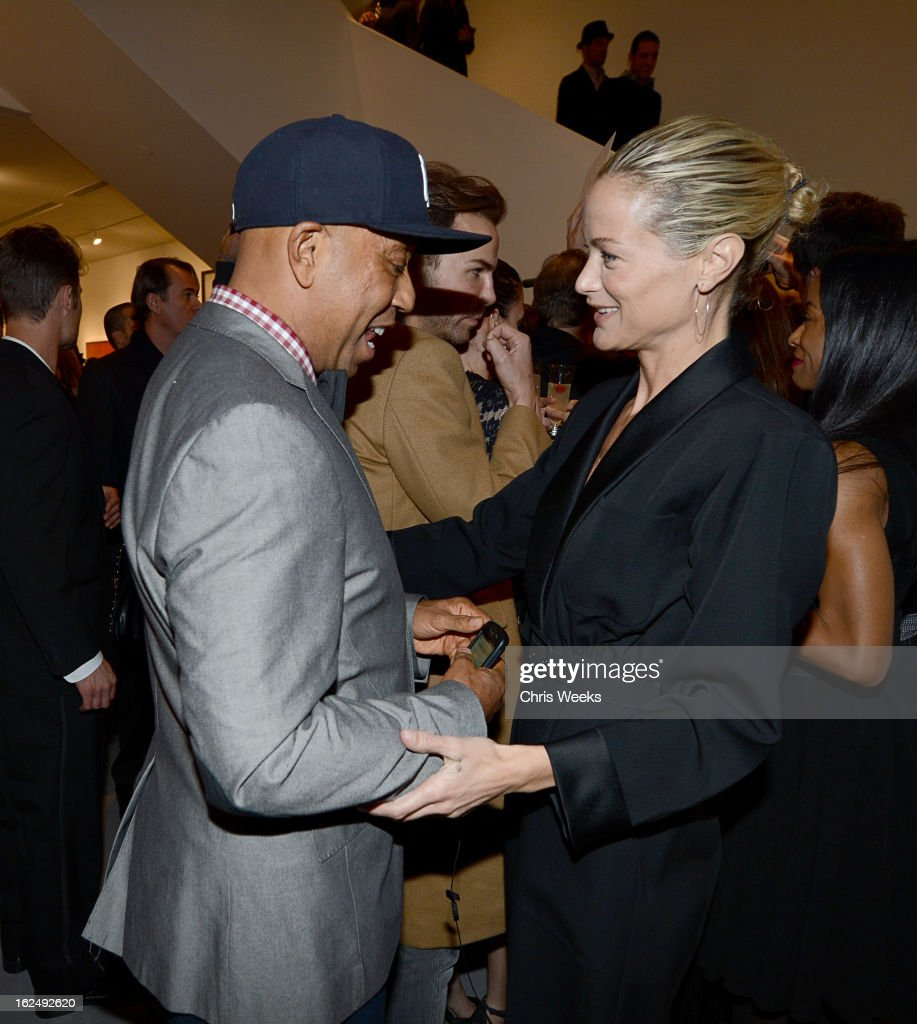 <a gi-track='captionPersonalityLinkClicked' href=/galleries/search?phrase=Russell+Simmons&family=editorial&specificpeople=202479 ng-click='$event.stopPropagation()'>Russell Simmons</a> and actress <a gi-track='captionPersonalityLinkClicked' href=/galleries/search?phrase=Carolyn+Murphy&family=editorial&specificpeople=211177 ng-click='$event.stopPropagation()'>Carolyn Murphy</a> attend a Private Reception For Mario Testino at PRISMon February 23, 2013 in West Hollywood, California.