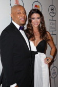 Russell Simmons and actress Shannon Elizabeth arrive at the 2014 HYUNDAI / GRAMMYs Clive Davis PreGRAMMY Gala Activation Equus Fleet Arrivals at The...