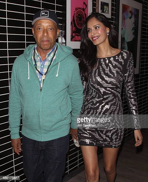 Russell Simmons and guest attend the A24 and The Cinema Society premiere of 'Locke' after party at The Skylark on April 22 2014 in New York City
