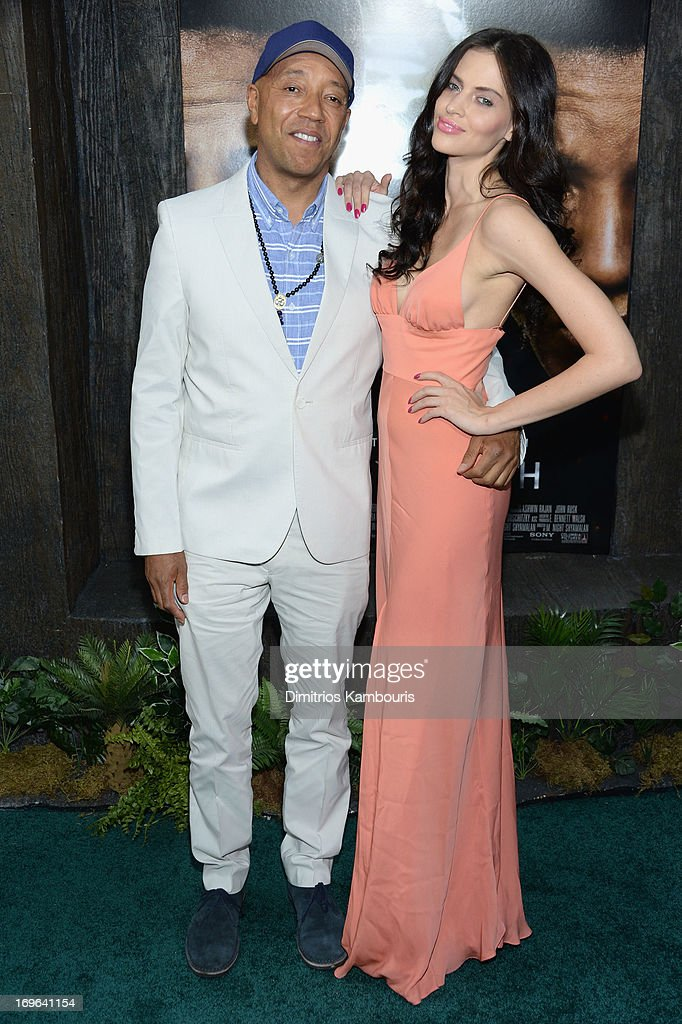 Russell Simmons and Hana Nitsche attend the 'After Earth' premiere at the Ziegfeld Theater on May 29, 2013 in New York City.
