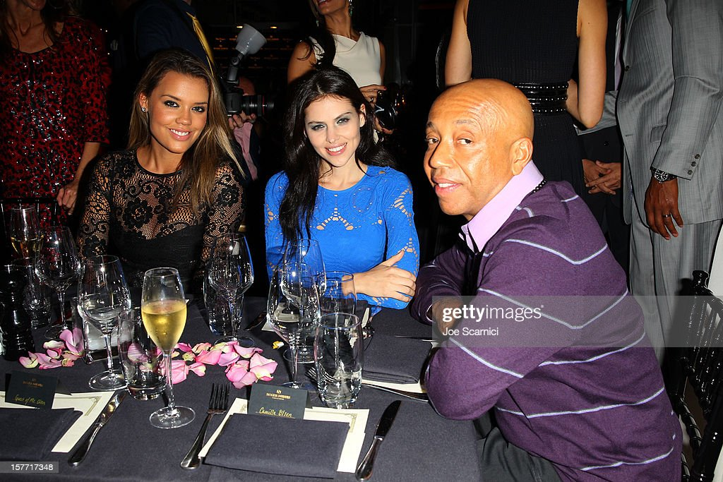 Russell Simmons (R) and Hana Nitsche attend the Haute Living and Roger Dubuis dinner hosted By Daphne Guinness at Azur on December 5, 2012 in Miami Beach, Florida.