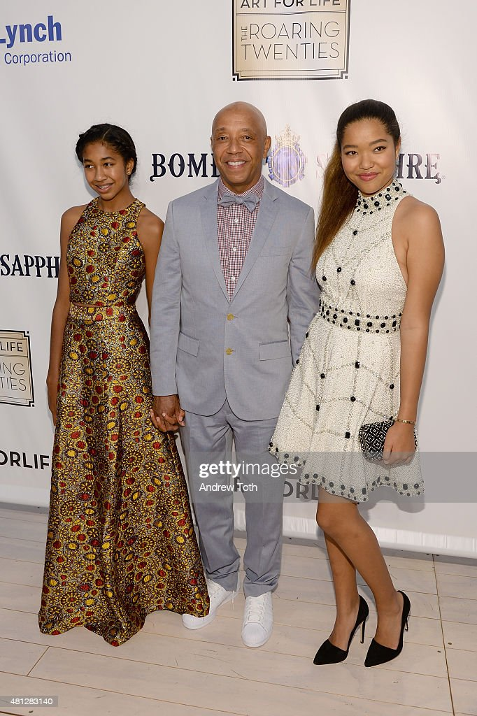 Russell Simmons and his daughters Aoki Lee and Ming Lee arrive as Russell Simmons' Rush Philanthropic Arts Foundation Celebrates 20th Anniversary At...