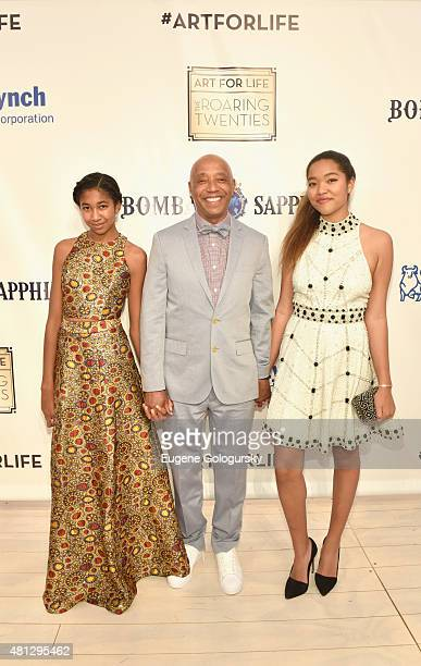 Russell Simmons and his daughters Aoki Lee and Ming Lee arrive as Philanthropic Arts Foundation Celebrates 20th Anniversary at Art For Life sponsored...