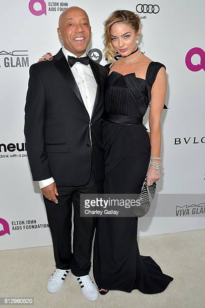 Russell Simmons and Lucy McIntosh attend Neuro at the 24th Annual Elton John AIDS Foundation's Oscar Viewing Party at The City of West Hollywood Park...