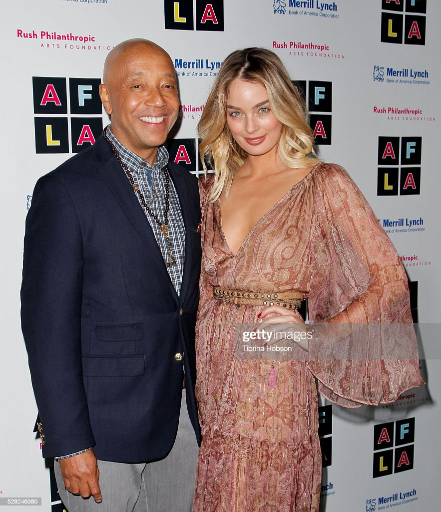 Russell Simmons and Lucy McIntosh attend Russell Simmons' Rush Philanthropic Arts Foundation's Inaugural Art For Life Celebration on May 3, 2016 in West Hollywood, California.