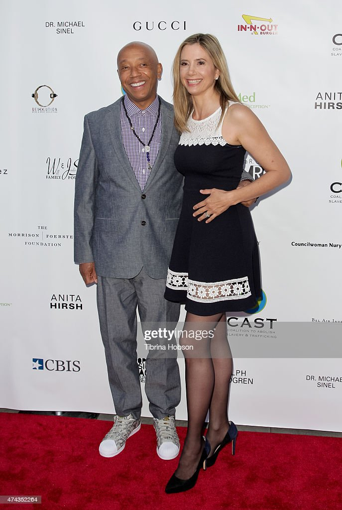 Russell Simmons and Mira Sorvino attend the 17th annual CAST from slavery to freedom gala May 21, 2015 in Los Angeles, California.