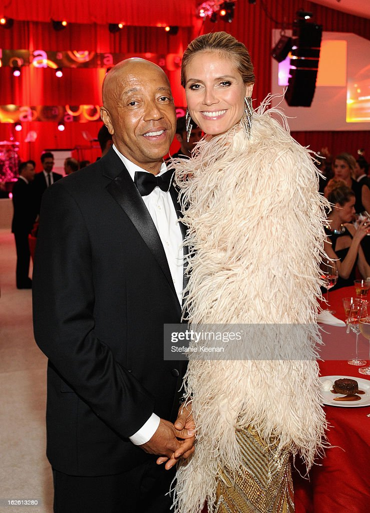 Russell Simmons and model Heidi Klum attend Chopard at 21st Annual Elton John AIDS Foundation Academy Awards Viewing Party at West Hollywood Park on February 24, 2013 in West Hollywood, California.