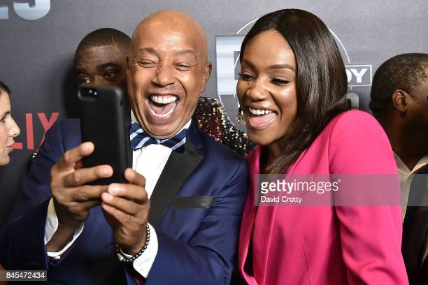 Russell Simmons and Tiffany Haddish attend Netflix Presents Def Comedy Jam 25 at The Beverly Hilton Hotel on September 10 2017 in Beverly Hills...