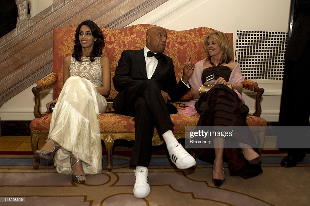 <a gi-track='captionPersonalityLinkClicked' href=/galleries/search?phrase=Russell+Simmons&family=editorial&specificpeople=202479 ng-click='$event.stopPropagation()'>Russell Simmons</a>, founder of Def Jam Records, center, and <a gi-track='captionPersonalityLinkClicked' href=/galleries/search?phrase=Mallika+Sherawat&family=editorial&specificpeople=233692 ng-click='$event.stopPropagation()'>Mallika Sherawat</a>, left, attend the Bloomberg Vanity Fair White House Correspondents' Association (WHCA) dinner afterparty in Washington, D.C., U.S., on Saturday, April 30, 2011. The dinner raises money for WHCA scholarships and honors the recipients of the organization's journalism awards. Photographer: Andrew Harrer/Bloomberg via Getty Images