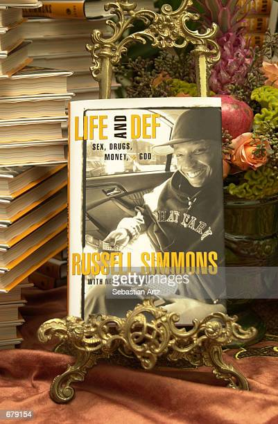 Russell Simmons new biography 'Life and Def Sex Drugs Money God' is on display at the book release party November 2 2001 in Bel Air CA