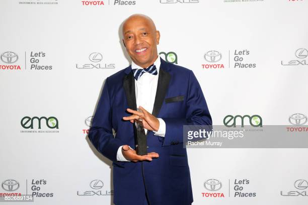 Russell Simmons poses backstage with the EMA Missions in Music Award at the Environmental Media Association's 27th Annual EMA Awards at Barkar Hangar...