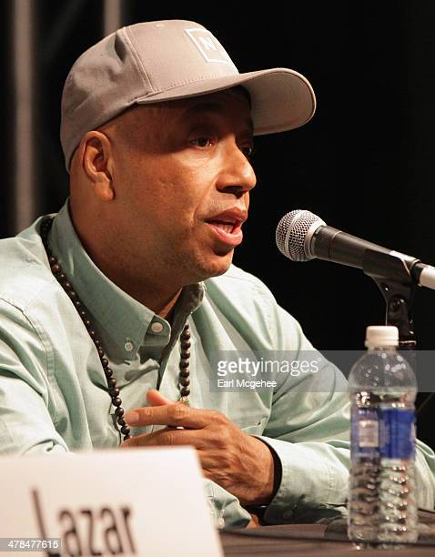 Russell Simmons speaks onstage at 'YouTube New Breeding Ground for Music's Future' during the 2014 SXSW Music Film Interactive at Austin Convention...