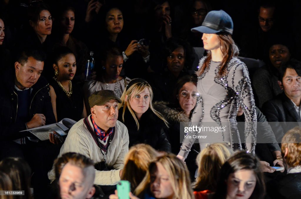 <a gi-track='captionPersonalityLinkClicked' href=/galleries/search?phrase=Russell+Simmons&family=editorial&specificpeople=202479 ng-click='$event.stopPropagation()'>Russell Simmons</a> watches the the Herve Leger By Max Azria Fall 2013 show during Mercedes-Benz Fashion Weekat The Theater at Lincoln Center on February 9, 2013 in New York City.