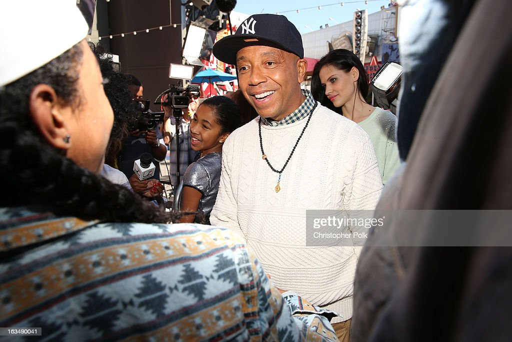 "<a gi-track='captionPersonalityLinkClicked' href=/galleries/search?phrase=Russell+Simmons&family=editorial&specificpeople=202479 ng-click='$event.stopPropagation()'>Russell Simmons</a> with Mindless Behavior at Universal CityWalk for the premiere of ""All Around The World"" & a performance presented by Target at Universal CityWalk on March 10, 2013 in Universal City, California."