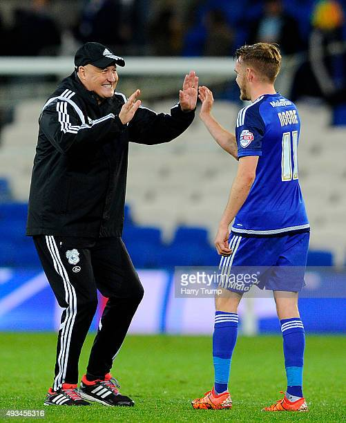 Russell Slade Manager of Cardiff City celebrates victory with Craig Noone of Cardiff City during the Sky Bet Championship match between Cardiff City...
