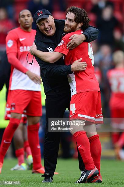 Russell Slade manager of Leyton Orient celebrates victory with Romain Vincelot of Leyton Orient after the Sky Bet League One match between Leyton...