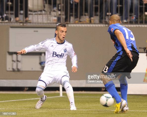 Russell Teibert of the Vancouver Whitecaps looks to check Matteo Ferrari of the Montreal Impact during the finals of the Amway Canadian Championship...