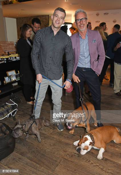 Russell Tovey and Patrick Cox attend the launch of Rosewood's Canine Luxury Experience hosted by Rosewood London and Barbour at Rosewood London on...