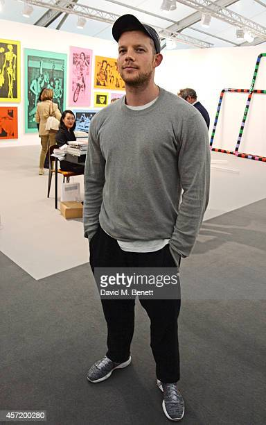 Russell Tovey attends VIP Preview of the Frieze Art Fair 2014 in Regent's Park on October 14 2014 in London England