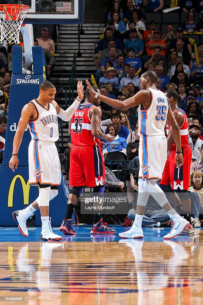 <a gi-track='captionPersonalityLinkClicked' href=/galleries/search?phrase=Russell+Westbrook&family=editorial&specificpeople=4044231 ng-click='$event.stopPropagation()'>Russell Westbrook</a> #0 and <a gi-track='captionPersonalityLinkClicked' href=/galleries/search?phrase=Kevin+Durant&family=editorial&specificpeople=3847329 ng-click='$event.stopPropagation()'>Kevin Durant</a> #35 of the Oklahoma City Thunder celebrate during a game against the Washington Wizards on March 27, 2013 at the Chesapeake Energy Arena in Oklahoma City, Oklahoma.